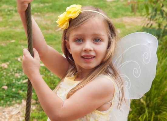 Young girl dressed as a fairy smiling at the camera Larissa Hill Photography special needs kids photographer